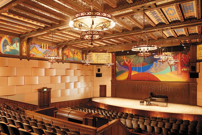 The state-of-the-art Littlefield Concert Hall features stunning murals, intricate ceiling tiles, wrought iron chandeliers, encircled by sound-proofed walls.