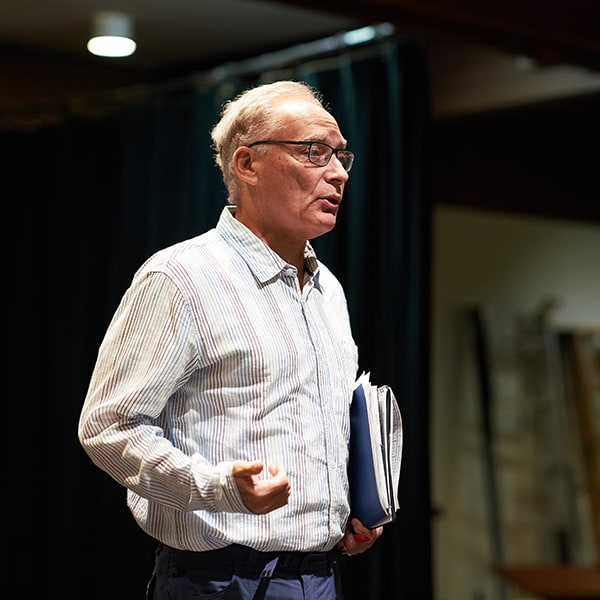 Actor, director, playwright, and Mills professor Victor Talmadge provides notes to Mills College theater studies students in Oakland, California.